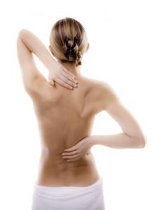 Schmerzen, Woman massaging pain back, Fotolia.de